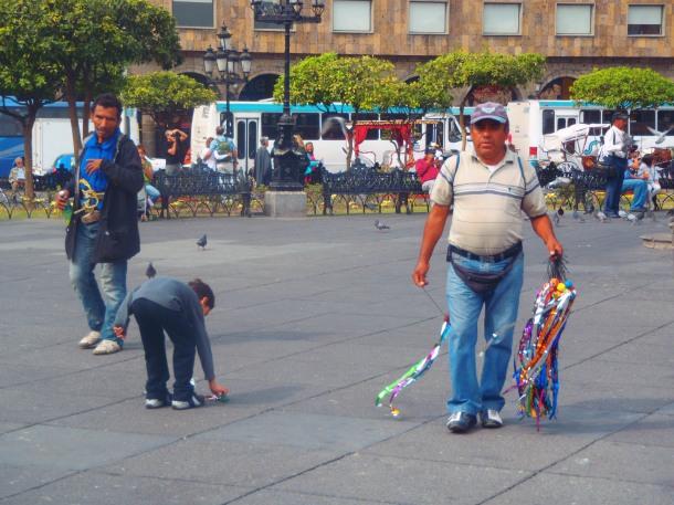 A vendor sells bouncy streamers.