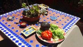 Fresh produce lunch on the charming outdoor terrace at my delightful Airbnb in Valencia.