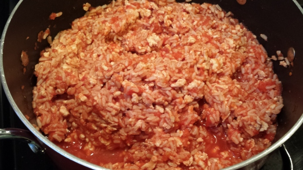 Simmer ground turkey, diced tomatoes, brown rice, and spices on stovetop.